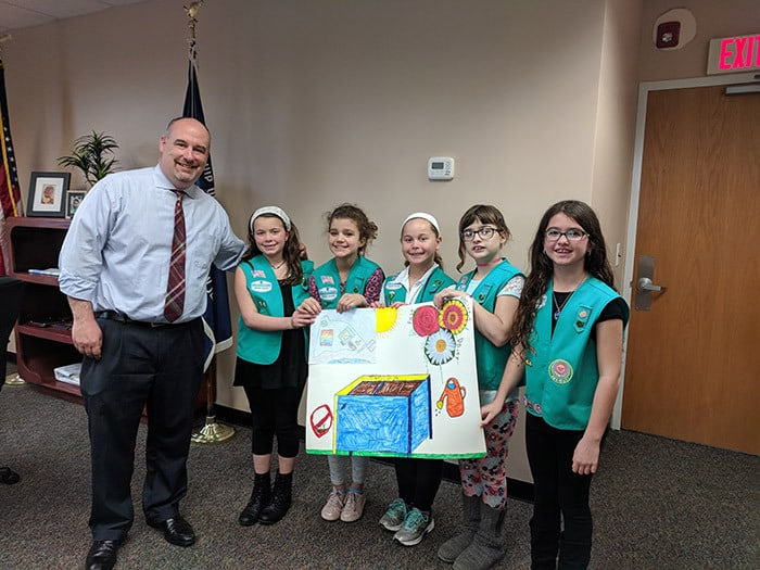 Girl Scout troop comprised of homeless members holds 1st cookie sale