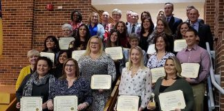 The 2019 Teachers of the Year and Educational Services Professional of the Year gather at the Jackson Memorial High School Fine Arts Auditorium during a Jan. 15 School Board meeting where they received their awards. (Photo by Bob Vosseller)