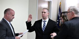 Manchester resident Kevin Rembach gets sworn in. (Photo courtesy Manchester Township)