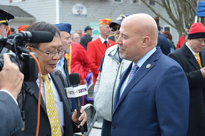 Congressman Tom MacArthur speaking with Vietnamese News Reporters from Washington D.C. during an event in Barnegat in 2018. (Photo by Bill Clanton, Jr.)