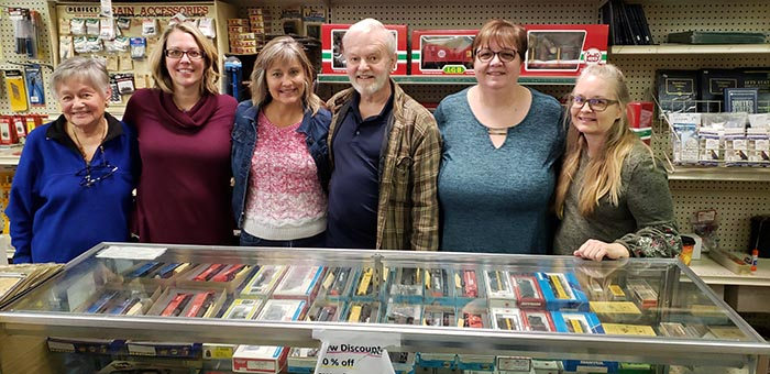 The matriarch of the Jackson Hobby Shop, Sylvia Gustafson, left, joins family members Ann-Marie Porrino, Jeanette Tepel, Frank and Debbie Gustafson and Doreen Burkhart during the shop's closing day on Jan. 19 after 50 years in business. (Photo by Bob Vosseller)