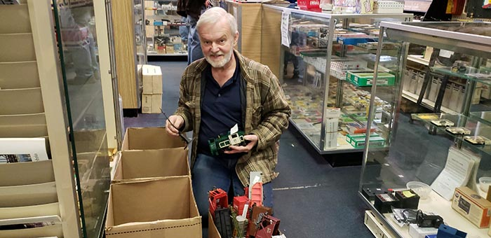 Frank Gustafson, owner of the Jackson Hobby Shop, packs up some miniature trains during the last day of operation of the business which noted a half century of operation this year. (Photo by Bob Vosseller)