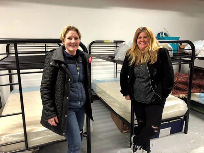 Seeds Of Service Executive Director Christie Winters, left, and Moira Edge, who runs the Bay store are in a room that will temporarily house volunteers who come to help with their mission. (Photo by Judy Smestad-Nunn)