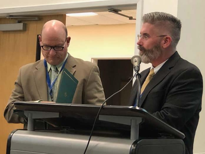Dennis Filippone, the retiring director of planning, research and evaluation, and Superintendent Gerard Dalton (L to R) handed out certificates to each board member for School Board Recognition Month. (Photo by Judy Smestad-Nunn)