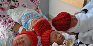 Babies at Jersey Shore Medical Center wear knitted red hats to raise awareness for heart health. (Photo courtesy American Heart Association)