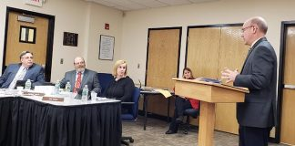 John Swisher of the auditing firm Suplee, Clooney and Company, Westfield, addresses the Jackson Board of Education about its finances and audit during a recent meeting of the school board. (Photo by Bob Vosseller)