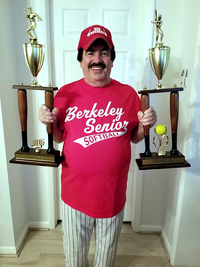 Norm Hoatling displays the trophies won by his summer and fall teams in the Berkeley Senior Softball League. (Photo courtesy of AnneMarie Hotaling)