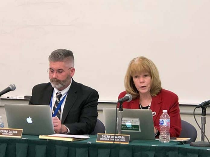 Susan McNamara, Director of Planning, Research and Evaluation, discusses district goals, sitting beside Superintendent Gerard Dalton. (Photo by Judy Smestad-Nunn)