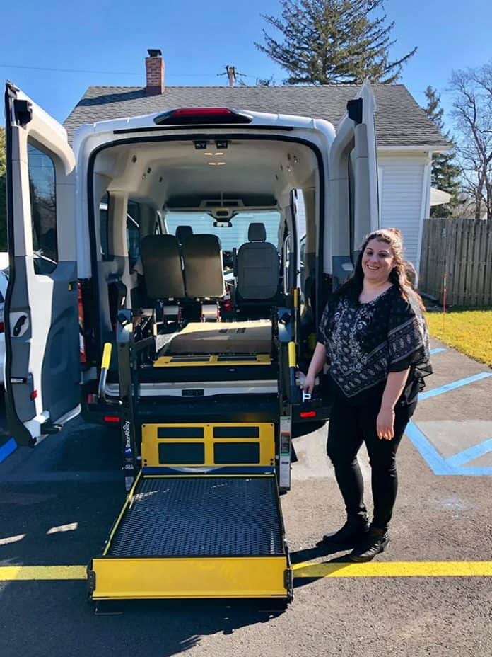 Group home manager Danielle Burdi demonstrates the wheelchair-accessible van used for residents. (Photo by Judy Smestad-Nunn)