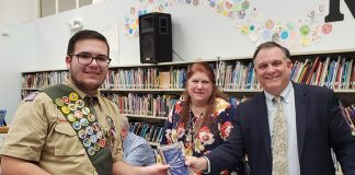 Eric Derco was honored by Board President Jackie Bermudez and Superintendent David Trethaway. (Photo courtesy Manchester Township School District)