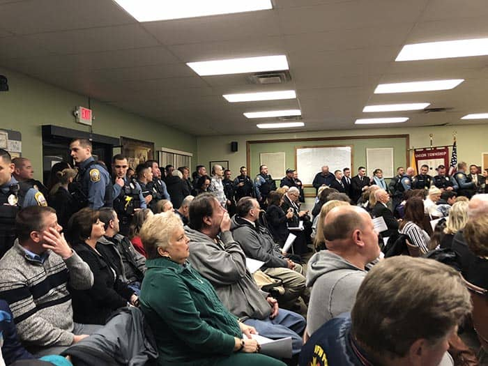 The meeting was packed with the families and friends of the five officers being honored by the council at the March 5 meeting. (Photo by Kimberly Bosco)