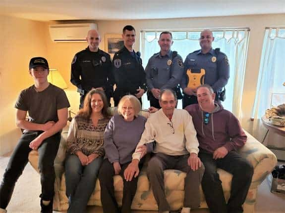 Back row, left to right: EMT Paul Witham, EMT Supervisor Anthony Botts, Ptl. Mark Storch, and Ptl. Anthony Chadwick (holding an AED). Front row, left to right: Shane Cartwright, Roberta Cartwright, Susan Schwab, Carl Schwab, and Peter Cartwright. Not pictured, EMT Kyle Matthews. (Photo courtesy Brick Police)