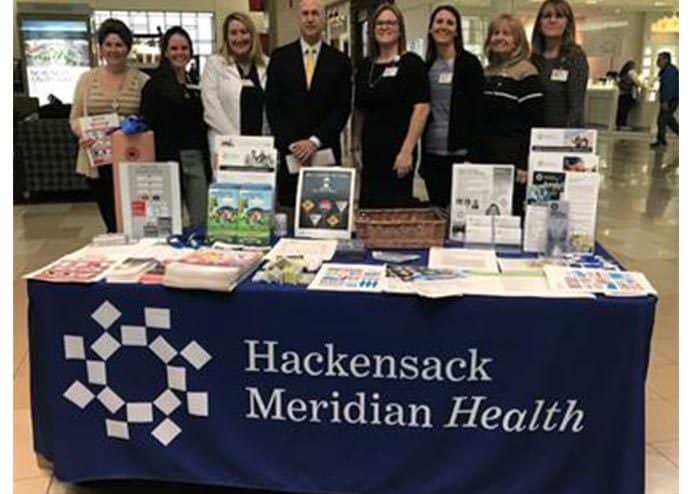 (Left to right): Tracy Nerney, Christine Frugard, Colleen Murphy, Dr. Bradley Pulver, Ryan Hill-Husosky, Melissa Kirchner, Patty Strassburg, and Kathy Feeney. Joanne Varner was not present for the photo. (Photo courtesy Ocean Medical Center)