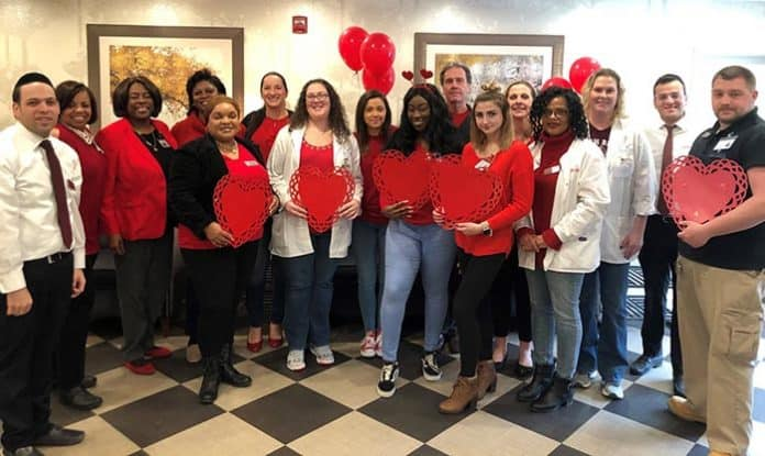 "Staff at Willow Springs Rehabilitation & Healthcare Center went ""red for women"" to celebrate cardiac health awareness recently. (Photo courtesy Willow Springs)"