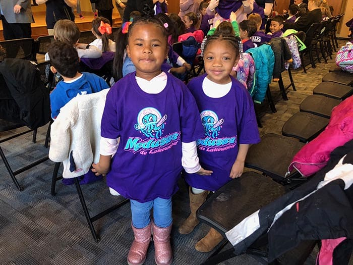 Two O.C.E.A.N., Inc. girls donned their new Medusas shirts over their regular outfits. (Photo by Kimberly Bosco)