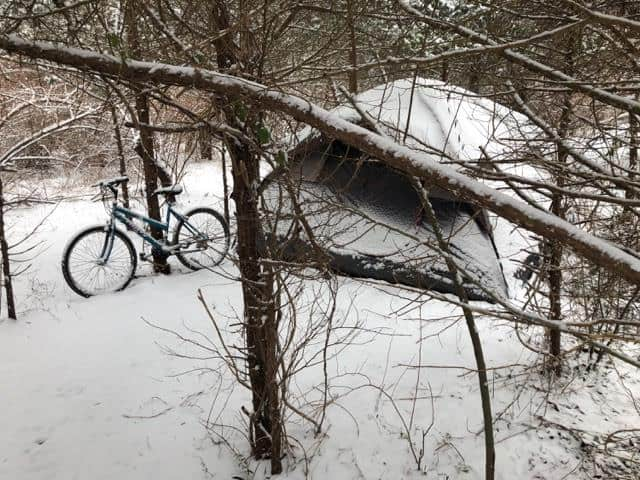 The few remaining homeless at the Route 9 site have had to brave a cold winter. (Photo by Cindy Lanouette)