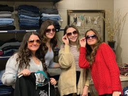 Students don sunglasses during a shopping spree at the McAuliffe Middle School Vintage Shop. (Photo courtesy Jackson Township School District)