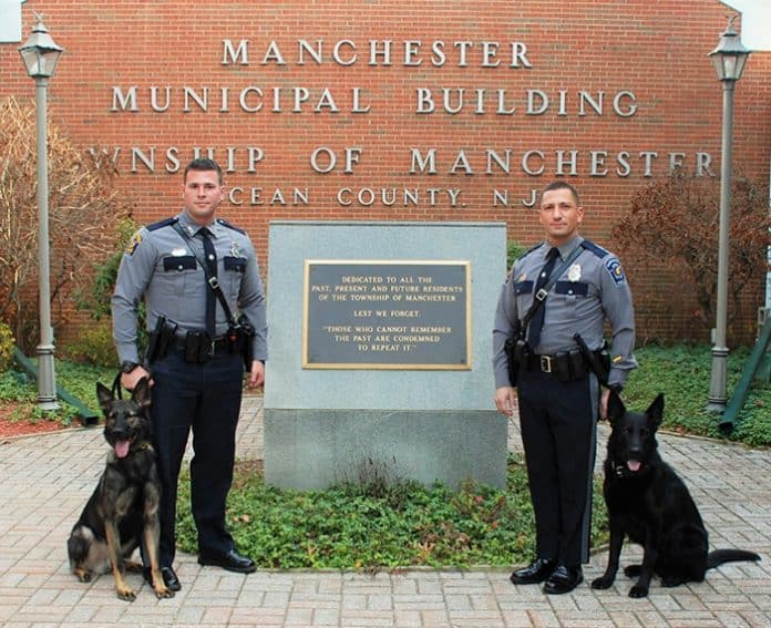 K-9 Officer Steven Wendruff and K-9 Lynk and K-9 Officer Marc Micciulla and K-9 Storm. (Photo courtesy Manchester Township Police Department)