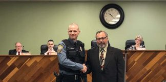 Patrolman Kristopher Burke with Deputy Mayor John Novak. (Photo by Kimberly Bosco)