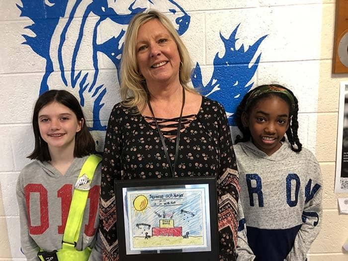 8515b9db001 Lanes Mill Elementary School 5th Grade teacher Sharon Panek poses with  contest winners. For essay