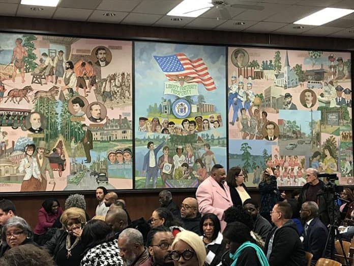 A large crowd filled the Lakewood Municipal Building. (Photo by Chris Lundy)