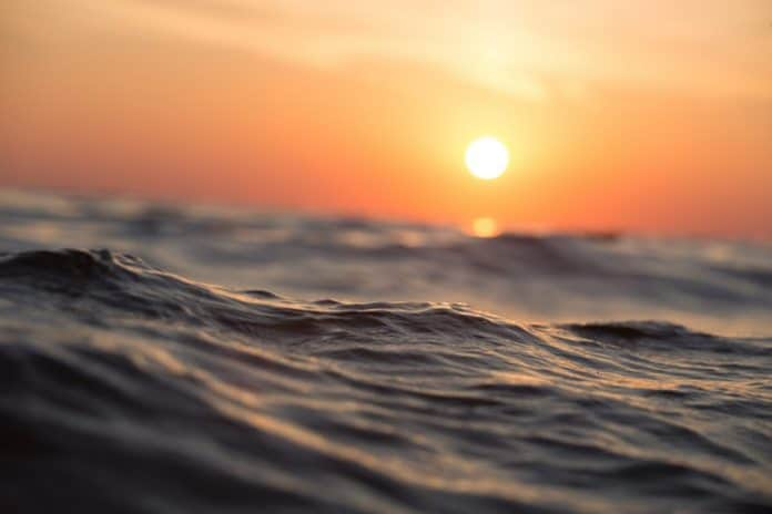 Ocean wave at sunset. (File photo)