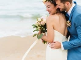 Bride and groom at the beach. (File photo)