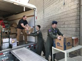 Volunteers helped bring thousands of books to the school. (Photo by Chris Lundy)