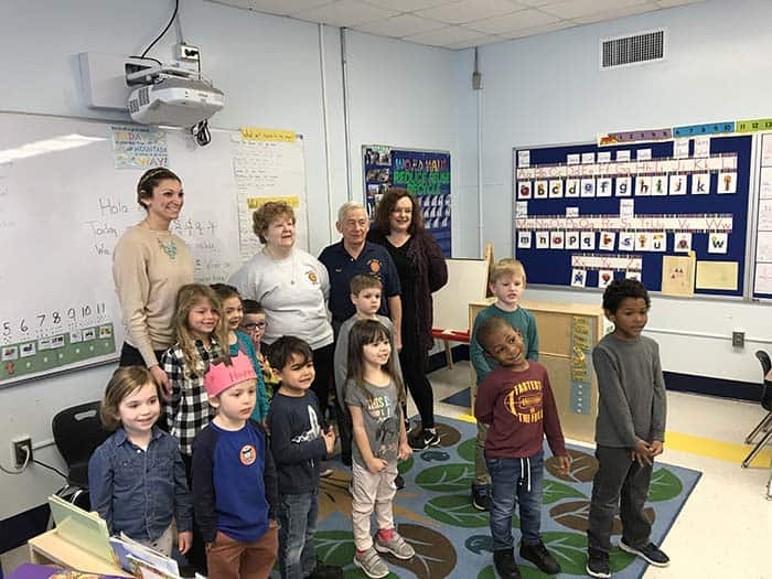 "Alyssa Peters' pre-kindergarten class just sang ""The Star Spangled Banner"" in honor of their new flag. They are posing with Bob and Darlene Scheiderman and Board of Education member Deborah Pease. (Photo by Chris Lundy)"