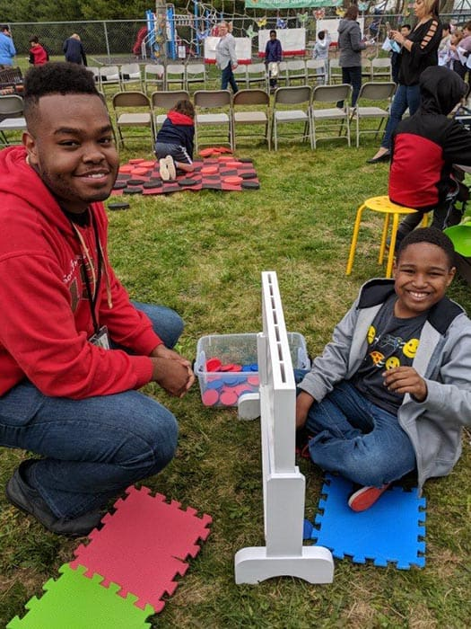 Paraprofessional JaQuinn Robinson and student Devon Boswell enjoy the strategy station of the Bulldog Retreat. (Photo courtesy Skye Donzelli)