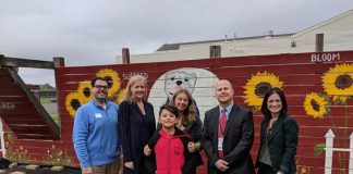 OceanFirst Bank representatives Joseph Tuzzio and Katherine Durante, Memorial teacher Skye Donzelli and Official Tour Guide and Peace Leader student Jhoan Arcila, and Principal Ray Gredder and Vice Principal Chrissy Anderson-Remo. (Photo courtesy Skye Donzelli)