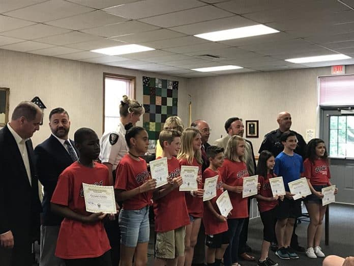 The Berkeley Township governing body honored the D.A.R.E. role models for the year. (Photo by Chris Lundy)