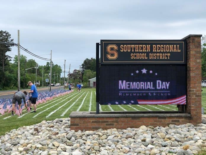Students plant flags in memory of American soldiers lost in Afghanistan and Iraq. (Photo by Kimberly Bosco)