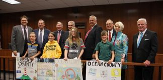 Poster contest winners pose with county officials. (Photo courtesy Ocean County)