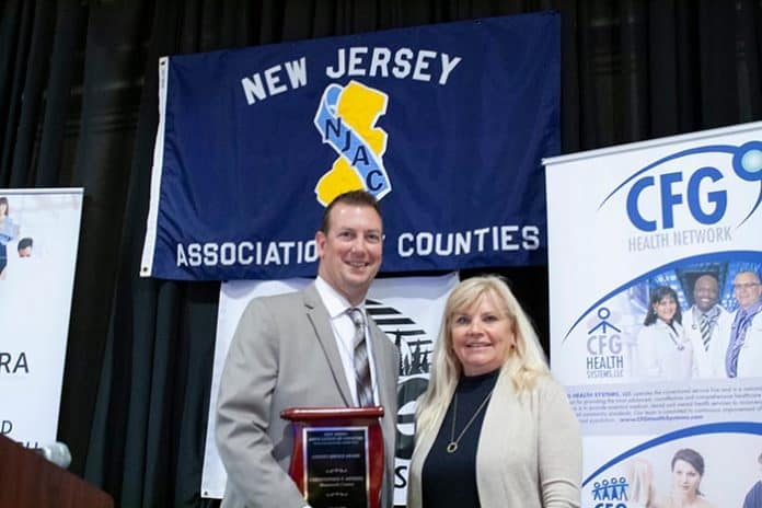 Monmouth County Public Health Coordinator Christopher P. Merkel was recently honored for his commitment to local government with county service award. (Photo courtesy Monmouth County)