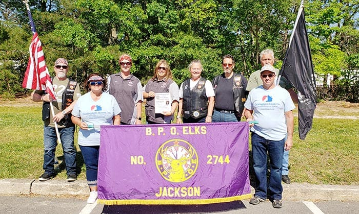 Members of the Jackson Elks Lodge gather before the parade staging area. (Photo by Bob Vosseller)