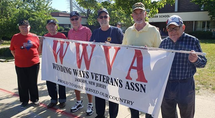 Winding Ways Veteran Association members Les Bauer, left, joins Marvin Stern, Ron Ely, Dave Gould, Bill Ballard and Richard Pudlin prepare for the start of the Jackson Memorial Parade. (Photo by Bob Vosseller)