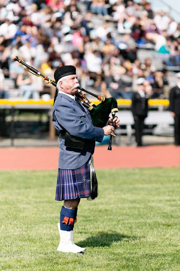 """Amazing Grace"" was played on the bagpipes by Robert Solan. (Photo by Jennifer Peacock)"
