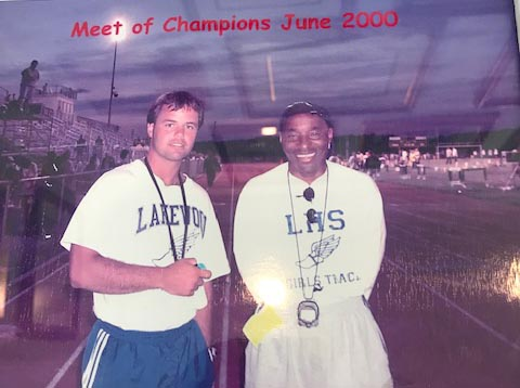 Jack Boylan (left), then the head coach of the Lakewood High School girls spring track and field team, shares a moment with assistant coach David Sauls. (Photo courtesy Jack Boylan)