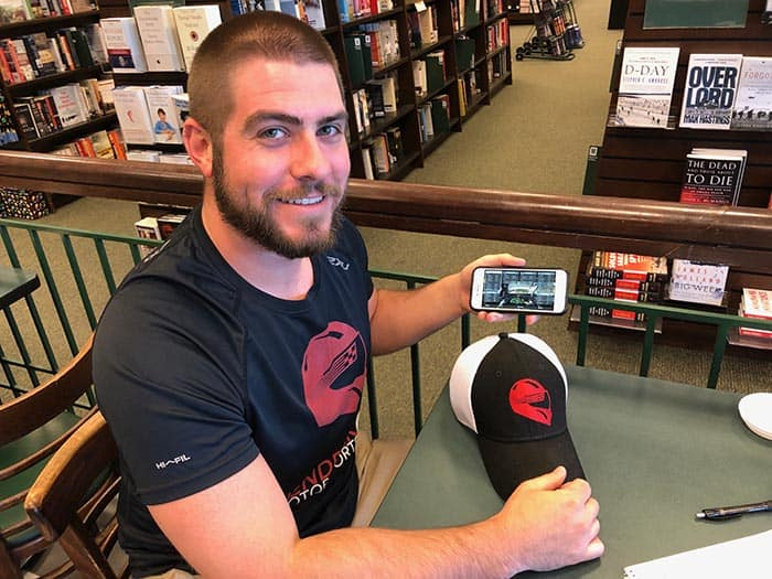 During an interview at Barnes and Noble in Brick, Nick Jobes shows the settings of his digital car that need to be adjusted prior to the race. (Photo by Judy Smestad-Nunn)