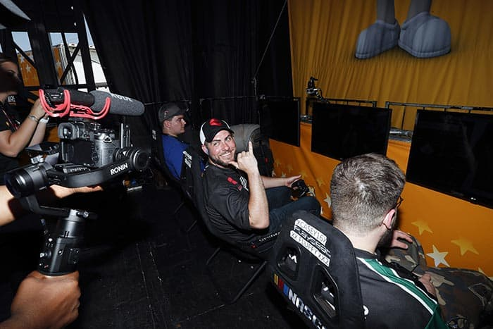 Nick Jobes waves to the camera during the first eNASCAR Heat Pro League race at Charlotte Motor Speedway. (Photo courtesy Hendrick Motorsports)