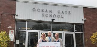Ocean Gate PTO volunteers Crystal Perrenod and Alisa Capuano, and Superintendent Frank Vanalesti hold the ceremonial check. (Photo courtesy Ocean Gate PTO)