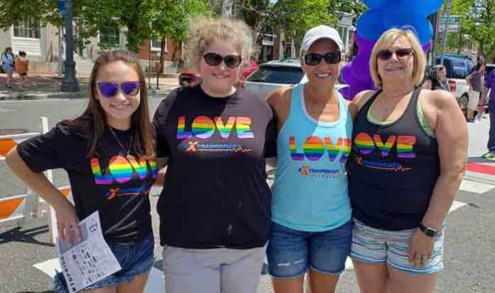Juliana Lamonica, left, joins Justine Applegate, Petra LaMonica and Doreen Applegate in their matching shirts provided by Extraordinary Fitness in Toms River at the Toms River Pride Day. (Photo by Bob Vosseller)