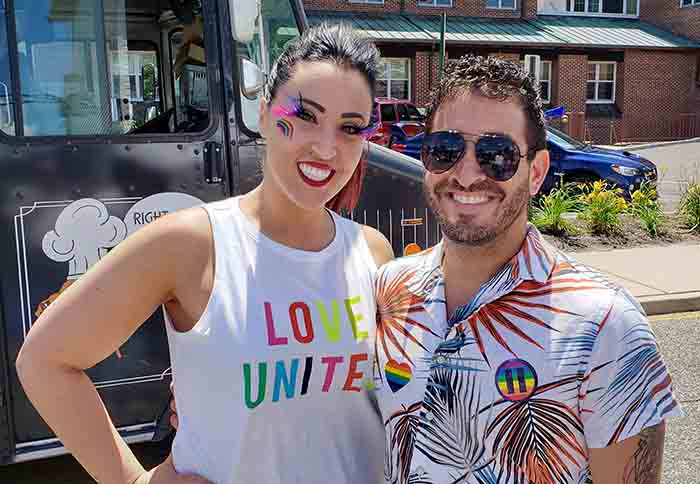 Event volunteers Kelly and Adam Servodio assisted with Pride Day's first activity which was a festival held on Robbins Street and included games, a scavenger hunt, vendors and several food trucks. (Photo by Bob Vosseller)