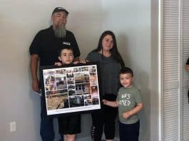 Chris Sullivan and the OCVTS team were rewarded for their efforts with thanks in the form of a framed collage from the Smith family, comprised of photos taken throughout the construction process. (Photo by Kimberly Bosco)