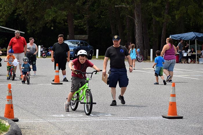 Participants wove their way through an agility course at the annual Bicycle Rodeo. (Photo courtesy Denise Maynard)