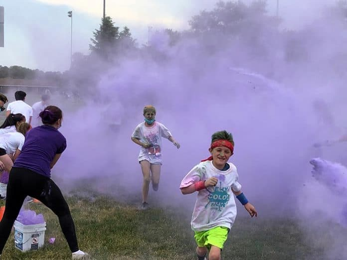 Colored corn starch paints the runners purple. (Photo by Judy Smestad-Nunn)