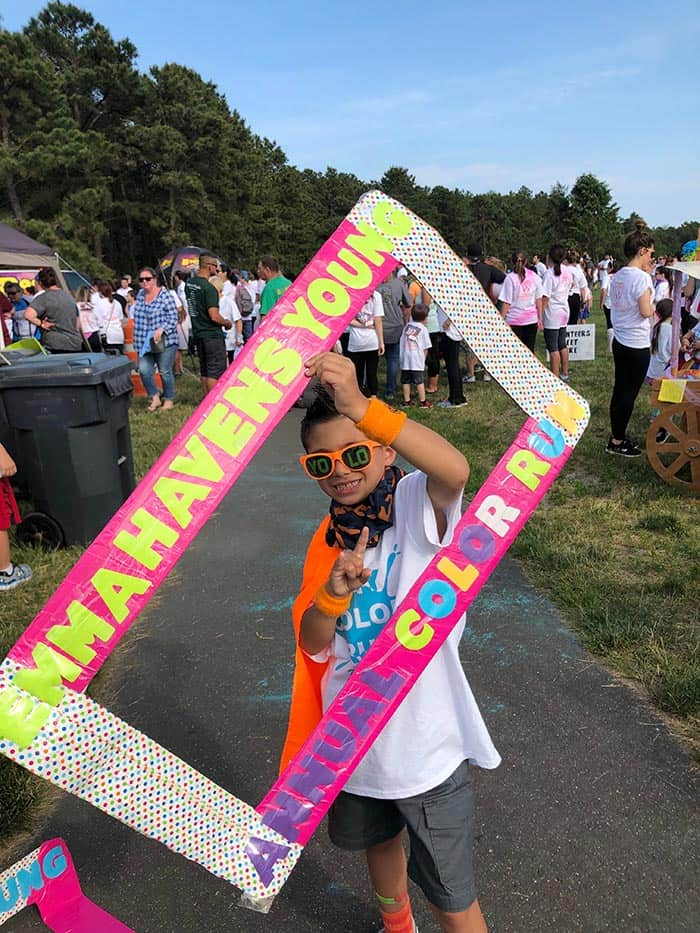 Vincent Policriti, 7, a 1st grader at EHY holds the Color Run frame prop. (Photo by Judy Smestad-Nunn)