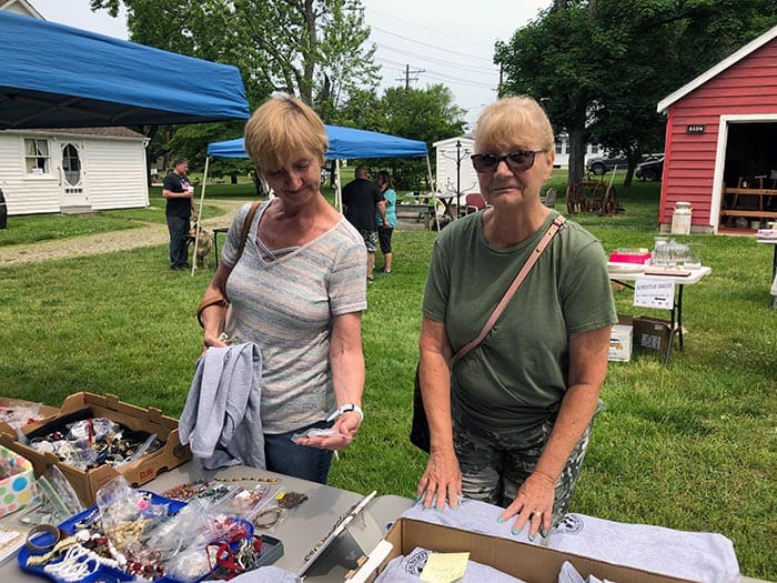 Sisters-in-law Anne Emerson (left) and Patty Wilder shop the sale. (Photo by Judy Smestad-Nunn)