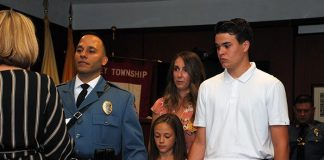 Officer Dimitrios Tsarnas was promoted to the rank of Sergeant. He was joined by his wife, Allison, and two children. (Photo courtesy Lacey Township Police)